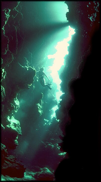 Freddy, deep in a coral cavern off the island of Ouvea in the Loyalty Island group of New Caledonia. Click to join us in the caverns of Sea's Remembering.